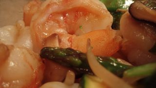 Shrimp stir-fry with vegetables and shiitake mushrooms