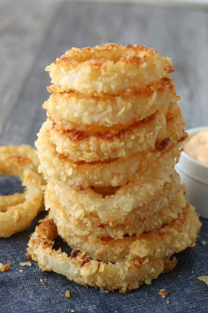 A stack of perfectly crunchy baked onion rings ready to be eaten.