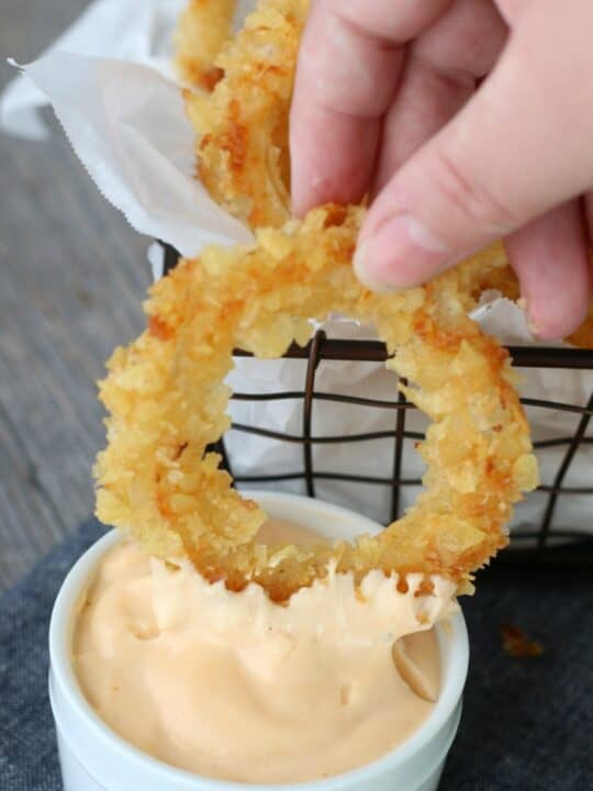 Onion ring dipped in aioli