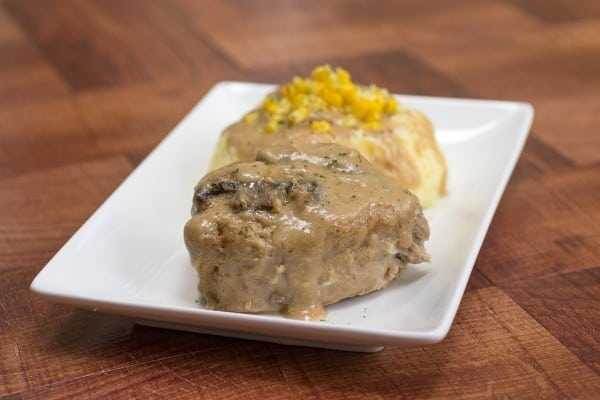 These made-from-scratch slow cooker pork chops with creamy mushroom gravy are so tender, moist, and delicious!