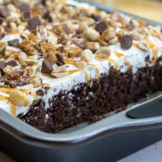 Homemade Snickers Cake Recipe with Peanuts, Caramel, and Chocolate