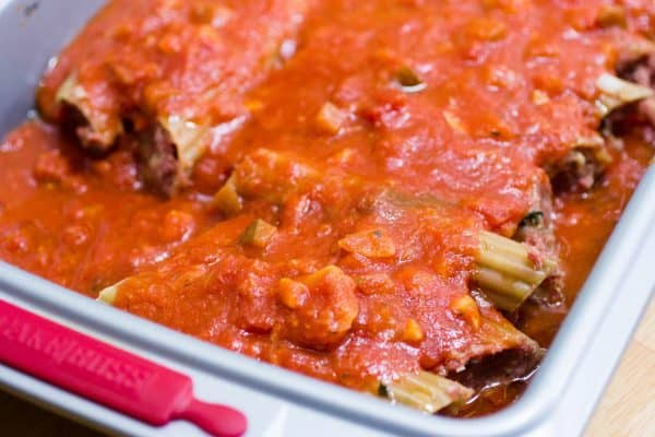 Top the manicotti with the rest of the sauce.