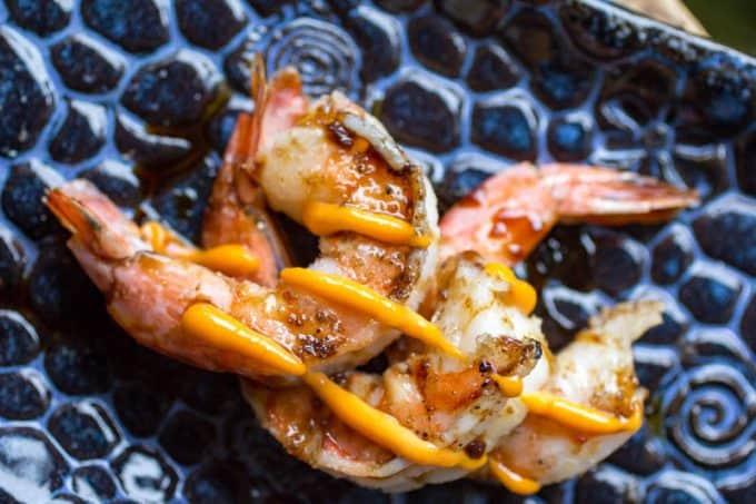 Teriyaki Smoked Shrimp on a blue textured platter