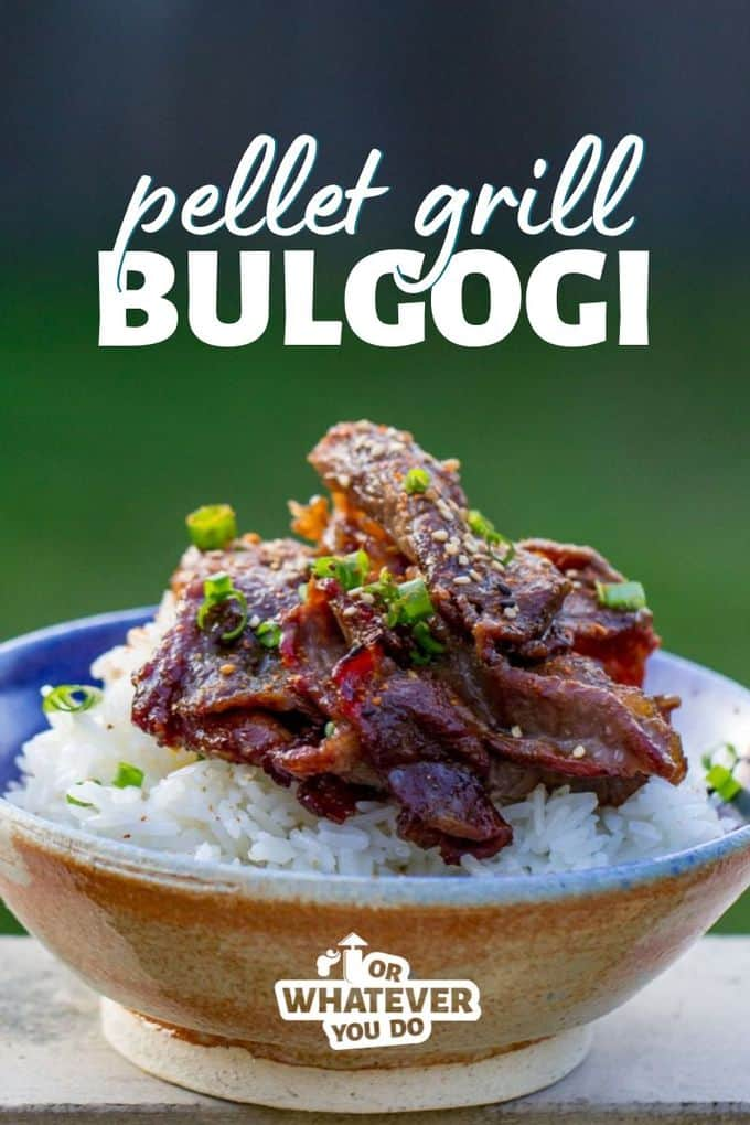 Beef Bulgogi on top of a bed of rice in a blue pottery bowl