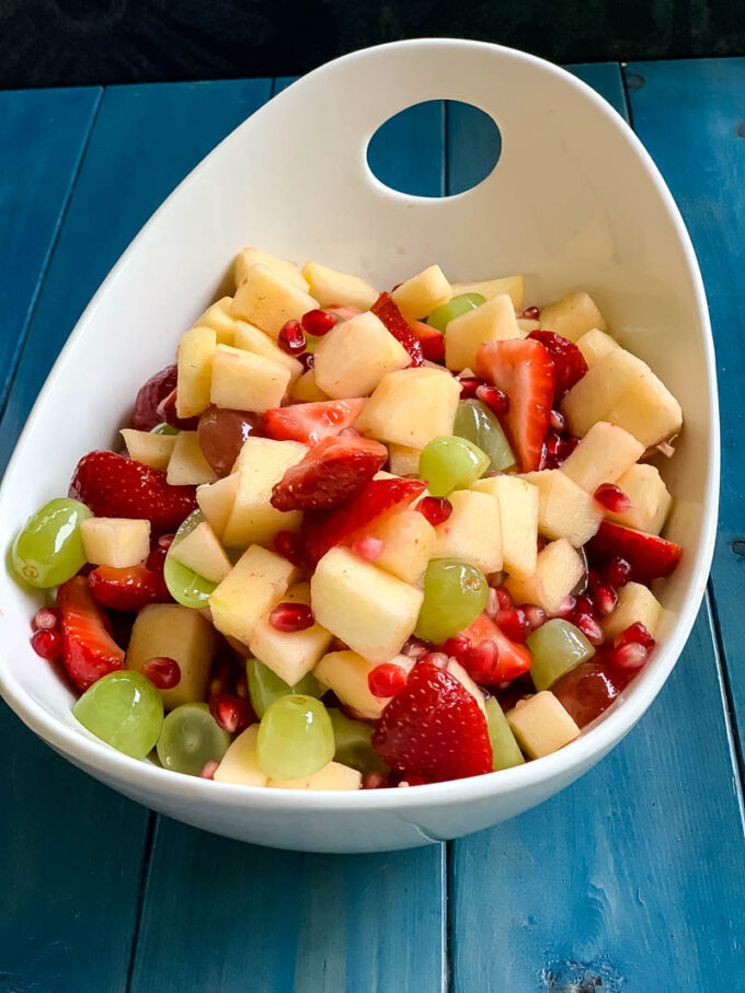 Fruit salad in a large white bowl