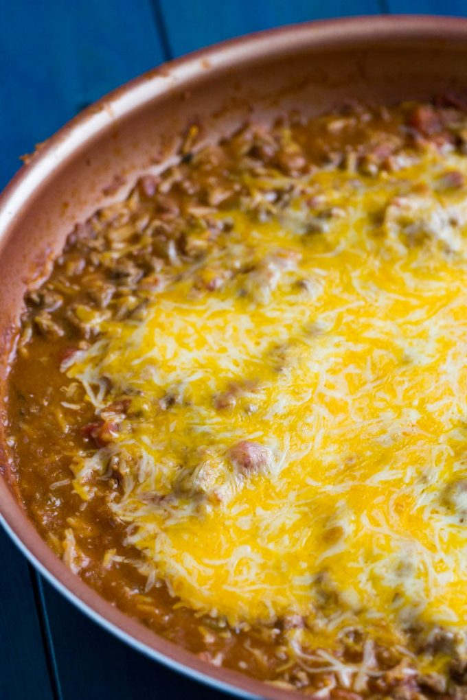 beef and bean burrito skillet with melted cheese on top