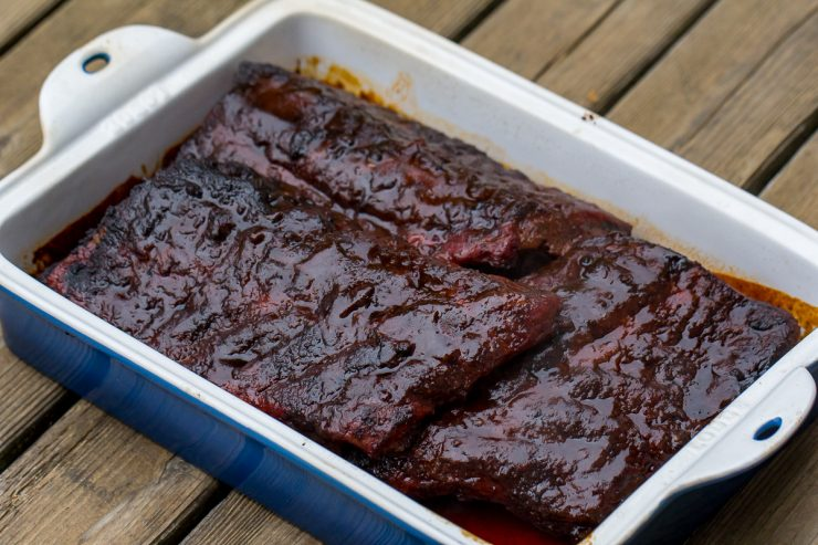 Ribs in a cast iron pan with sauce