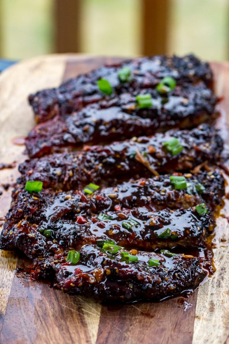 Sticky Asian Pork Ribs on a cutting board