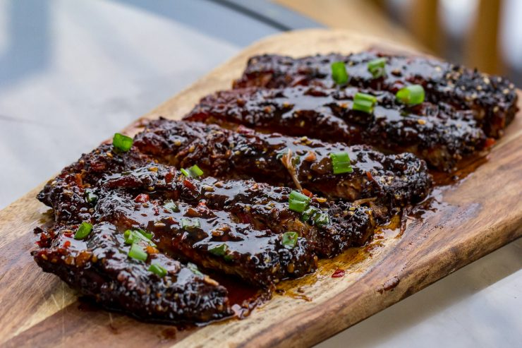 Spicy Asian Pork Ribs on a wooden cutting board