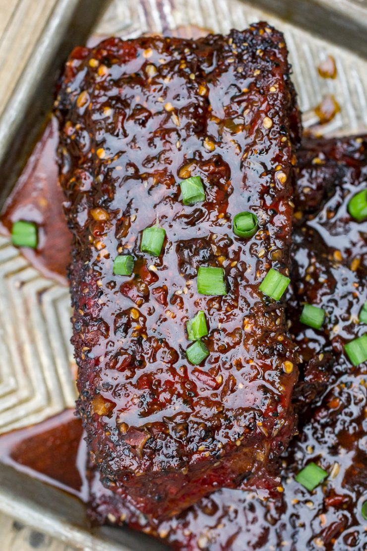 Spicy Asian Pork Ribs on a gray baking sheet