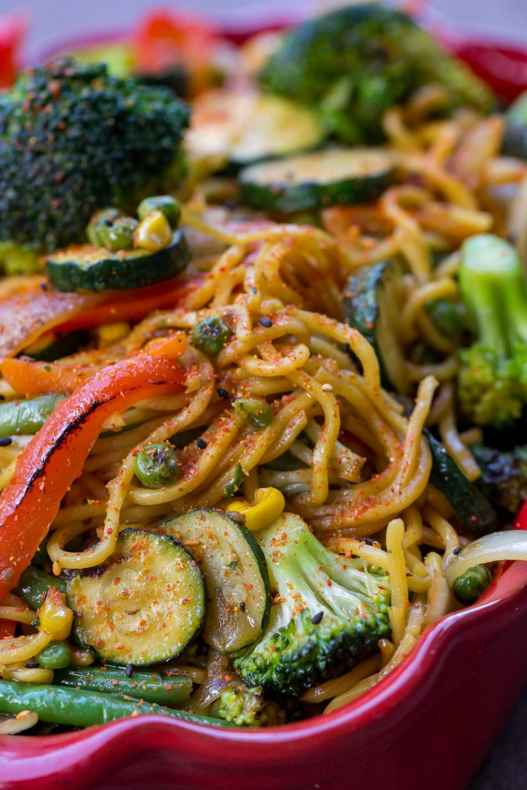 Vegetable Yakisoba close up with lots of broccoli, zucchini, and red bell pepper slices