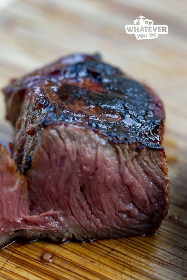 Flat Iron Steak sliced in half cooked medium rare