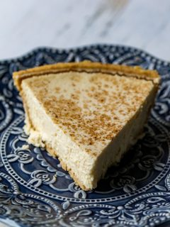 This homemade eggnog cheesecake is the perfect mix of sweet and rich, and is topped with a sprinkle of cinnamon to really bring out the flavor of the eggnog!