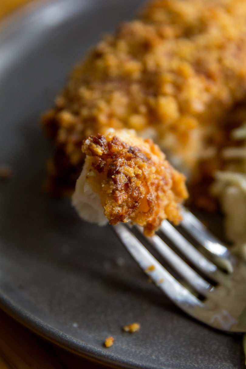 Bite of Air Fryer Parmesan Crusted Halibut on a fork
